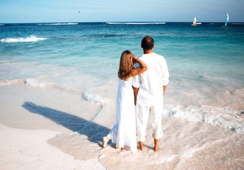 Loving couple looking the ocean