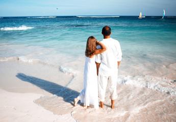 Loving couple looking the ocean