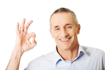 Mature man showing perfect sign