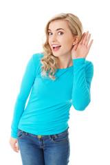 Full length woman overhearing a conversation