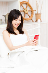 young asian woman in the bed room