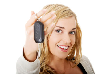 Portrait of happy woman holding a car key