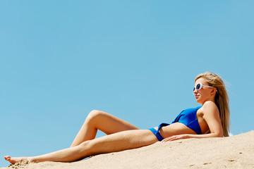 Full length woman lying on the beach