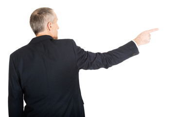 Businessman pointing to the right