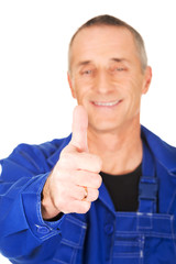 Portrait of repairman showing thumbs up