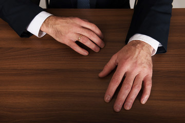 Businessman's hands put on the desk
