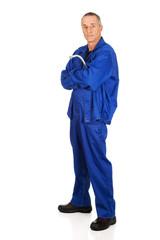 Full length repairman holding wrench