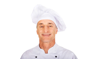 Professional chef in white uniform and hat