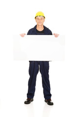 Full length happy worker presenting empty banner