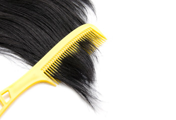 Comb on hair on white background