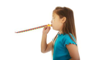 Girl blowing ribbon