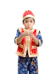 Little boy in dress for chinese new year on white background