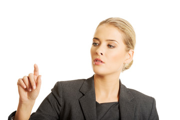 Businesswoman pressing an abstract button