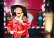 Leinwanddruck Bild - Little boy pretend as a fire fighter