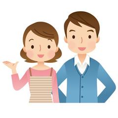 案内する若い夫婦