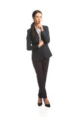 Full length businesswoman making silent sign