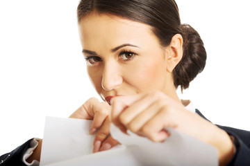 Portrait of businesswoman tear her paper notes
