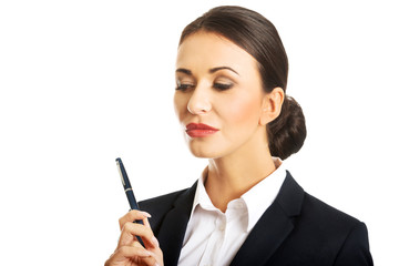 Portrait of thoughtful businesswoman holding a pen