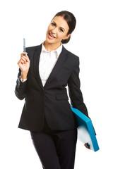 Happy businesswoman holding a pen