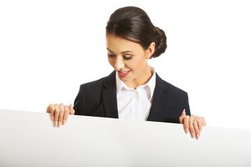 Portrait of businesswoman holding white banner