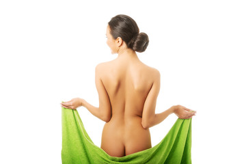 Back view woman wrapped in towel showing her bum