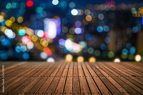 Blurred city lights and office buildings - 76288118
