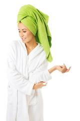 Woman in bathrobe looking down