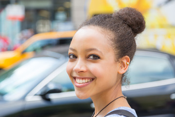 Beautiful Mixed-Race Young Woman in the City, Smiling Portrait