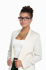 Portrait of business woman in white jacket standing