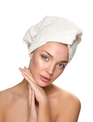 Beautiful woman with a towel on his head isolated