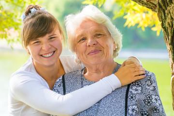 young girl hugging her beloved grandmother