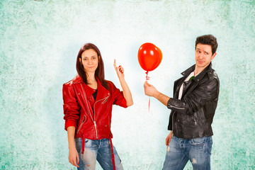 Handsome Man Giving Red Balloon to Woman