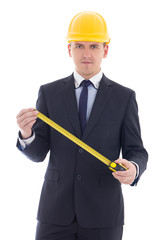 handsome business man or architect in yellow builder's helmet wi