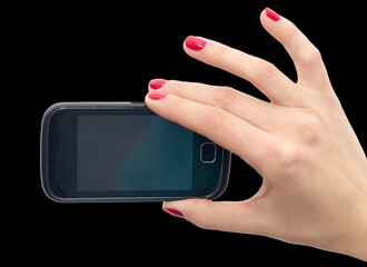 Cell phone in hand with red nail polish on a black background
