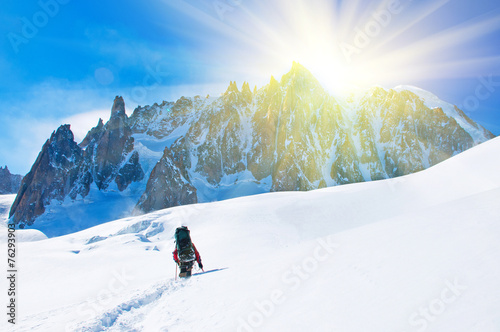 Extreme Sport. Lone hikers in winter mountains - 76293903