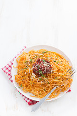 pasta with tomato sauce and parmesan on white wooden background