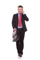 Young business man walking forward