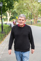 Retired Senior Man at Park, Walking and Relaxing, Smiling Expres