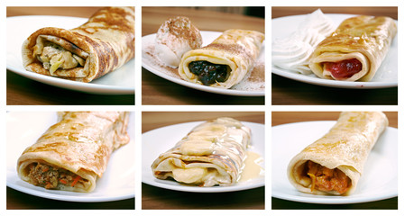 Food set of different rolled pancakes stuffed .