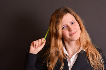 Young woman teacher having an idea pointing with a pen