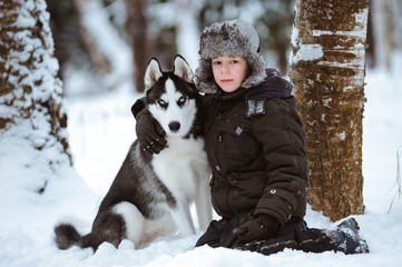 little boy with the dog