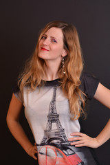 Happy and confident woman with tower Eiffel painted on shirt