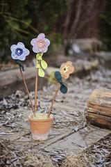 handmade fabric flowers in pot in spring garden