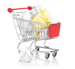 Recylcing concept with crumpled paper and shopping cart