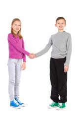 Two children shake hands