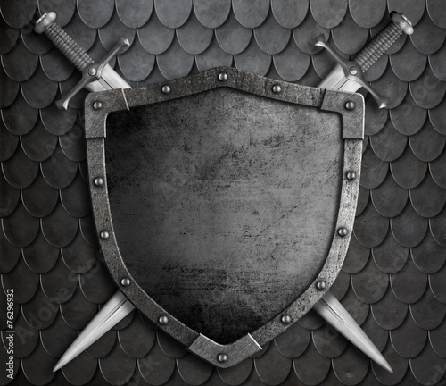 medieval shield with two crossed swords over scales armour - 76296932