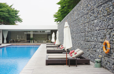 swimming pool with rock wall