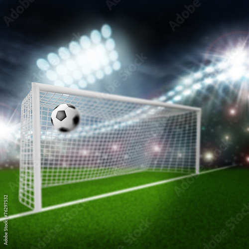 soccer ball flies into the goal - 76297532