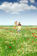 happy little girl running in the spring meadow