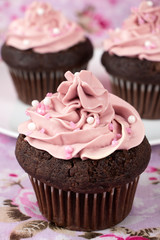 Chocolate cupcakes with pink buttercream